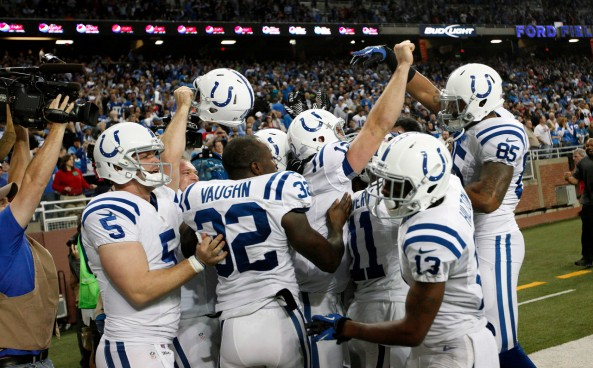 Indianapolis Colts quarterback Andrew Luck with teammates after a 14-yard touchdown to wide receiver Donnie Avery as time expired against the Detroit Lions in the fourth quarter of an NFL football game in Detroit, Sunday,