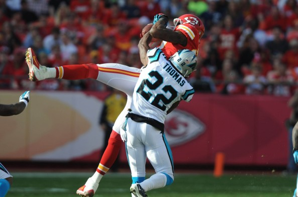 Kansas City Chiefs wide receiver Dwayne Bowe (82) catches a pass against Carolina Panthers cornerback Josh Thomas (22) in the first half at Arrowhead Stadium on Dec 2, 2012 in Kansas City, M