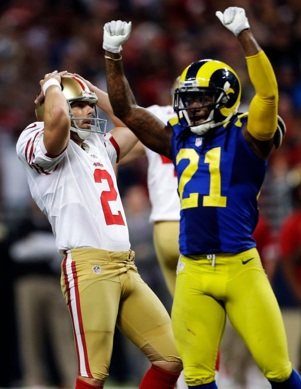 San Francisco 49ers kicker David Akers, left, and St. Louis Rams' Janoris Jenkins react after Akers missed a 51-yard field goal attempt in overtime of an NFL football game, Sunday, Dec. 2, 2012, in St. Louis. The Rams won 16-13